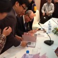 professor-larry-berman-signs-copies-of-the-new-edition-of-his-book-about-legendary-spy-pham-xuan-an-for-delegates-and-readers-during-the-book-launch-in-hanoi-photo-vov-1444075-anh-1-512×384